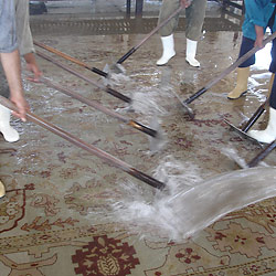 Washing and repairing a damaged rug.