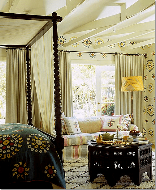 In Kathryn Ireland's ojai ranch house, she uses a Moroccan rug and table to create a colorful guest room. Image via Cote De Texas