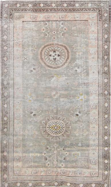 A Matt Camron faded antique Khotan