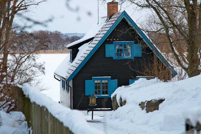 A quaint Swedish house with the frozen Baltic Sea in the background