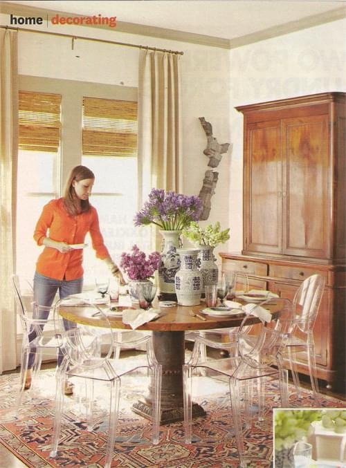 In Meg's dining room, she uses a beautiful Matt Camron Antique Heriz. The antique armoire is French from the 19th century. The dining table top is made from reclaimed cypress.