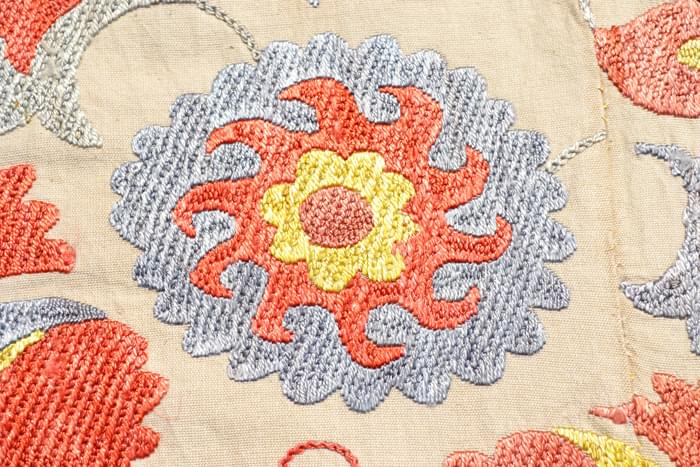 Detail of a beautiful carnation flower with accents of saffron, cochineal rust, and a pale indigo