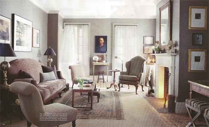 In the living room of a Hudson Valley town home, designer Peter Frank uses a small antique Oushak on top of seagrass. The rug alone would look too small in the room. This photo is from the October issue of House Beautiful.