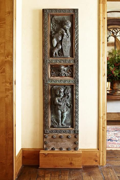 Eighteenth-century Venetian bronze doors flank the dining room archway. The antique doors are from Matt Camron as well.