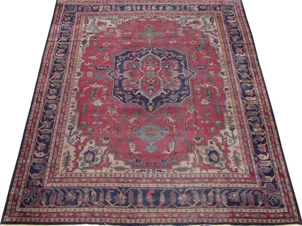 Antique Persian Worn Serapi Rug
