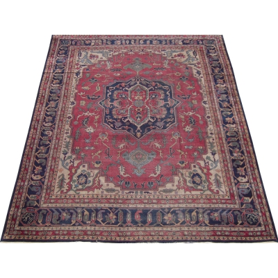 Antique Persian Worn Serapi Rug